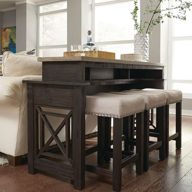 Bar stools beside wooden bar in living room